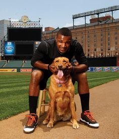 Orioles center fielder Adam Jones poses with Missy, his rescue Labrador mix.