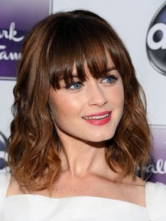 Alexis Bledel Natural (or curler-created) waves look easy and fresh on hair that hits just at the shoulders—and brow-skimming bangs up the girly appeal.