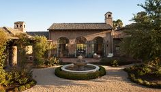 fountain and pea gravel.  dont' like color of house