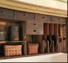 Old Wooden Shelf with Drawers...plate rack and old baskets & books.