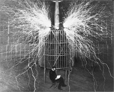 Nikola Tesla appears in a multiple-exposure photo in 1899, while a Tesla coil discharged millions of volts.
