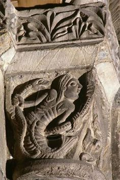 Mermaid corbel in the Chapter House, Durham Cathedral. 12th century