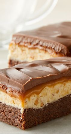 With chocolate, peanut butter and caramel, our Chocolate Caramel Commotion Bars are a triple threat! Melt chocolate chips & butter, then add our sweetened condensed milk & vanilla. Stir in flour, pour into a pan & bake. Melt butter, stir in sugar & cream. Boil, then add marshmallow, peanut butter & peanuts. Spread over baked layer. Cook caramels & cream, then spread over marshmallow layer. Cook chips & peanut butter & spread over caramel layer. Chill, then dig in!