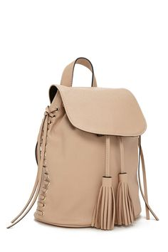 An unstructured faux leather backpack featuring straight-laced detailing with grommets on both sides, a snap-magnetic flap closure, a drawstring top with tasseled ends, two interior patch pockets, a top handle, and two adjustable shoulder straps.