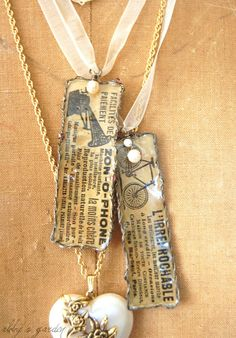 Original pinner said: I used snippets of ads from a vintage French newspaper to create pendants inspired by soldered jewelry.a look I find most enchanting. Paper Jewelry, Paper Beads, Jewelry Crafts, Jewelry Art, Vintage Jewelry, Jewelry Necklaces, Handmade Jewelry, Jewelry Design, Jewelry Ideas