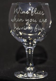 Wine flies where you are having fun  Hand engraved wine glass