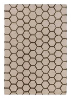 HONEYCOMB Tara Bernerd The silk motif of Tara's Honeycomb design varies subtly in width, giving an organic feel to the deceptively simple geometric pattern.Honeycomb is available from stock in a range of sizes.