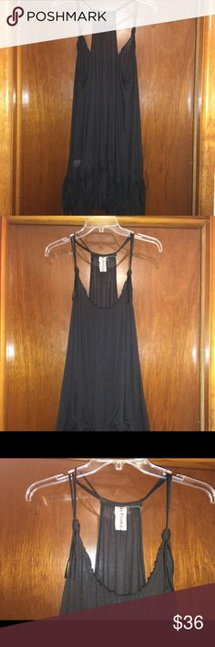 Free People Mini Strappy Black Dress SZ SM Very Cute Racer Back Free People Dress. Faux Leather shoulder straps. Size Small. Unique Tiered Bottom. See-Thru Free People Dresses Mini