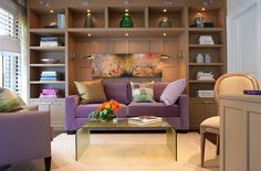 Fabulous sleeper sofa in purple and sconce lighting for the guest bedroom [Design: Cindy Ray Interiors]