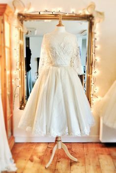 Joanne Fleming Design; 'Annie' (long sleeve version with lace hem) French lace and silk organza wedding dress