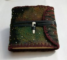 Feltbook #11 Stitched and beaded Resist dyed hand felted wool, leather lining, long stitch bound, bone and leather closure, Coptic endband edge stitching 5.25 x 3.75 3/2010 SOLD