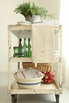 I have wanted a cart like this!  Wish I could find one to make my own. :D vintage styled cart. gorgeous!
