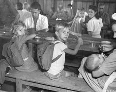 American children and other civilians held at Santo Tomas Internment Camp by Japanese forces for over three years are photographed having a . University Of Santo Tomas, Creepy History, Bataan, American Children, Interesting History, American Civil War, Women In History, Old Photos, Vintage Photos