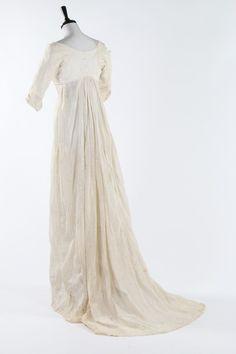 A whitework embroidered empire-line muslin dress, circa 1805.