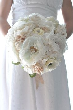 Vintage wedding bouquet, oldworld charm is captured by lace and pearls among paper flowers and flowers
