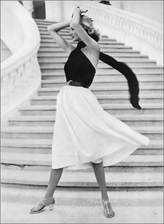Sunny Harnett in black boned halter with kite-tail scarf and white cotton skirt with woven-in tucks by Carolyn Schnurer, photo by Frances McLaughlin, Vogue, May 15, 1951