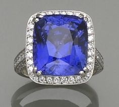 A sapphire, diamond and platinum ring  the cushion-shaped sapphire weighing 17.03 carats within a surround, gallery and shoulders of round brilliant-cut diamonds; estimated total diamond weight: 1.75 carats.