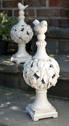 A large pair of carved limestone pineapple finials hmmm need