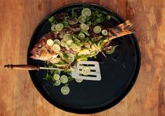 Whole Grilled Fish with Lime  With a dish this simple, you need the freshest possible fish—and good technique. Score the flesh down to the bone to encourage even cooking, and be patient when making the first turn: If you oil the grill grate well and give the fish time to cook through, the skin won't stick.