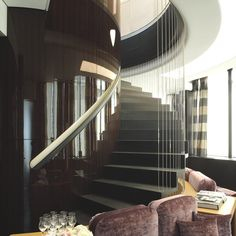 Sophisticated Triplex House: Get Your Home Higher!:Iron-grating-baluster-Futuristic-staircase-Gloss-beadboard-Modern-sofa