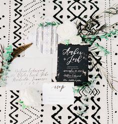 black and white modern invitations on mud cloth