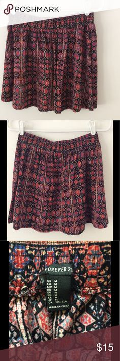 "Forever 21 - Patterned Mini Skirt - Size Medium Jewel tone colors of red, blue and pink dispersed on black. Material is soft and falls nicely...wear from Spring into Autumn. Elastic waist band. Length: 14 1/4"" Waist: 13 1/2""          Smoke Free/Dog Friendly Home🌸 Forever 21 Skirts Mini"