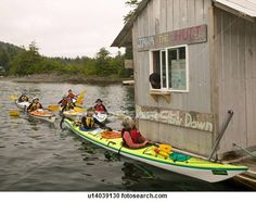 Stock Photography of 'Java The Hutt', a drive through floating coffee shop in the small native village of Kyuquot caters to Kayakers and recreational boaters alike. Kyuquot, Vancouver Island, British Columbia, Canada. u14039130 - Search Stock Photos, Pictures, Wall Murals, Images, and Photo Clipart - u14039130.JPG