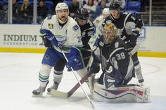 Tina Russell / Observer-Dispatch From left, Utica Comets player Brandon DeFazio reacts as San Antonio player Stephan Vigier holds him back during AHL hockey at the Utica Memorial Auditorium Thursday, Jan. 1, 2015. Read more: http://www.uticaod.com/apps/pbcs.dll/gallery?Site=NY&Date=20150101&Category=PHOTOGALLERY&ArtNo=101009998&Ref=PH&taxoid=&refresh=true#ixzz3Ndcy3Lfe