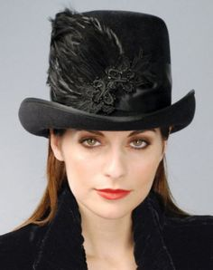 Louise Green Chatham Riding Hat  For a no-nonsense woman with a romantic side, a velour body with satin band, exquisite plumage and beadwork over Venetian lace.   $249.95