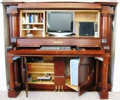 Upcyle an old piano to a computer desk, OMG this is so cool but I wouldn't even attempt this.
