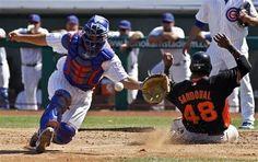 San Francisco Giants' Pablo Sandoval, right, scores past Chicago Cubs catcher Steve Clevenger