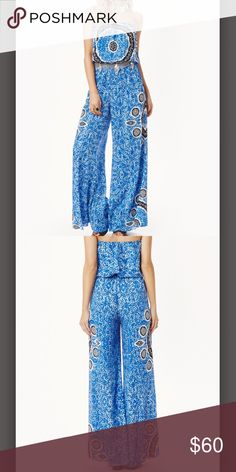 Blue Boho ALE BY ALESSANDRA JUMPSUIT This tie dye printed jumpsuit designed by supermodel Alessandra Ambrosia features an elastic waist and big bell bottom legs. Styled with belt, does not come with. Size M 100% Rayon Ale From Planet Blue. Worn Once, Perfect condition. Blue Life Dresses