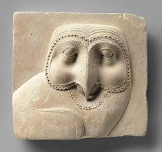 Relief plaque with face of an owl hieroglyph