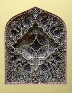 Looking like 3D versions of stained glass windows or ancient mandalas, these insanely intricate paper-cut sculptures use hundreds of layers of paper to build up their peacefully meditative forms.