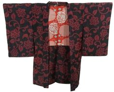 This is a retro vintage Meisen kimono with 'Karabana' (imaginary flower in China) pattern on the black background, which is woven