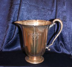 Wm Rogers eagle and star fluted silverplate pitcher, copper patina, with monogram and emblem,no ice lip.