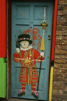 Beefeater on a Brick Lane door in East London, U.K.