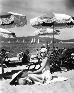 1955, Cannes, Nice. Grace Kelly on the beach. Location shot from the movie To Catch a Thief directed by Alfred Hitchcock.