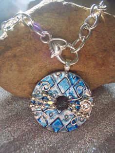 Beautiful Unique Blue Wire Wrapped and Beaded Washer Pendant. $21.00, via Etsy.