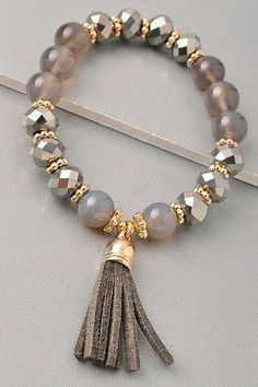 I like the small tassel on the bracelet.