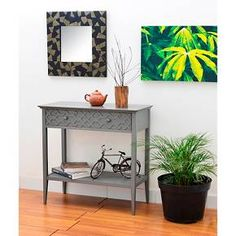 The Threshold Fretwork Console Table is sturdy, attractive and super fun. This console table is the perfect height to display your picture frames, a lamp, family treasures and more. Its detailed and stylish design is bound to draw a lot of attention. This Threshold console table is must-have for your home décor. Plus, it's an incredible value. This console table matches other pieces in Threshold's Fretwork collection. Maximum recommended weight capacity of 300 pounds.