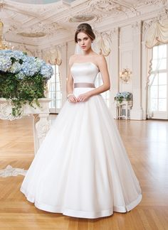 Lillian West lillian west style 6359 Tulle, matte satin ball gown accented with a sweetheart neckline.