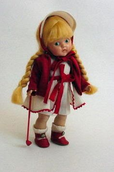 Vogue Painted Eye hard plastic GINNY forerunner by Vogue Dolls in all original 'Golfer' outfit, includes her red plastic golf glub.  This doll also came with a pot metal club.  Finding the doll with the club is very rare.  This photo was uploaded by mertziemuldoon.