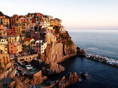 http://travel.nationalgeographic.com/travel/coastal-destinations-rated/italy-essay/    Cinque Terre, an Italian seaside village