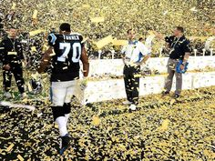 Carolina Panthers guard Trai Turner walks through the falling confetti at Levi's Stadium dejected following the team's loss to the Denver Broncos 24-10 in Super Bowl 50.