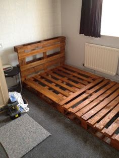 DIY Pallet Bed-- might put in the spare bedroom once I get it a little more under control and organized.