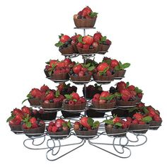 Create beautiful presentations, and charm your guests with this decorative Wilton 307-651 38-count display stand! The multi-tier towering design features whimsical, silver-finished wire spirals, truly creating a sweet display. Use this stand for anything from cupcakes and muffins to appetizers, fruits, and mini desserts - the possibilities are endless! Use your creativity and imagination during the holiday season by using this tiered stand for green-iced cupcakes. Its twisting, towering…