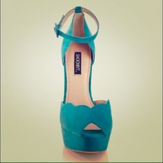"""Shoemint Chloe Turquiose sandal Reach new heights with this vintage inspired platform Mary Jane. Scallop trim gives classic black and taupe a new twist, while turquoise channels the season's coolest shade.turquoise suede  5 _Ã"""" heel, 1 _Ã"""" platform  Scalloped top line with buckle detail  Suede upper  Similar shoes sell for $195.95 and higher* Shoemint Shoes"""