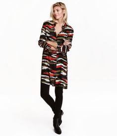 Khaki/patterned. Long, straight-cut shirt in airy, woven viscose fabric. Narrow…
