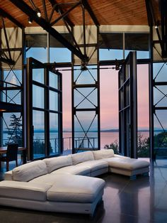 Industrial Living Room | Massive oversize panels match the scale of the view beyond. Eight feet wide and 16 feet tall, they are opened via a geared, motorized mechanism, similar to an overhead door operator.
